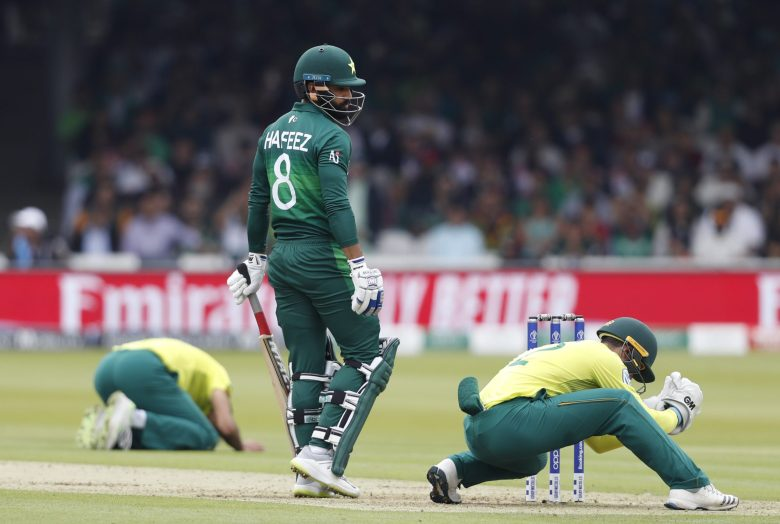 Pakistan's Mohammad Hafeez looks round after South Africa's wicketkeeper Quinton de Kock, right and bowler South Africa's Imran Tahir, react
