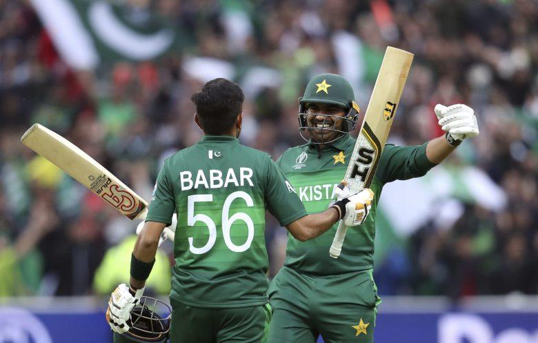 Pakistan's batsman Haris Sohail, right, embraces teammate Babar Azam for scoring a century