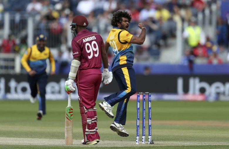 Sri Lanka's bowler Lasith Malinga, right, reacts after dismissing West Indies' batsman Sunil Ambris