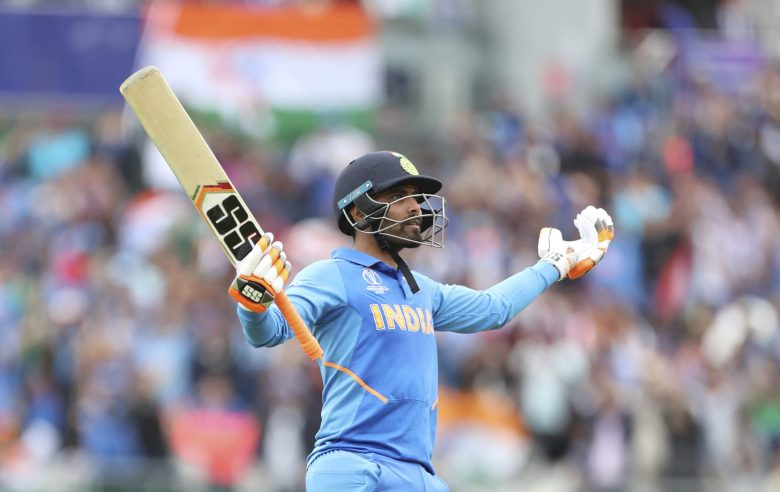 India's Ravindra Jadeja celebrates scoring fifty runs