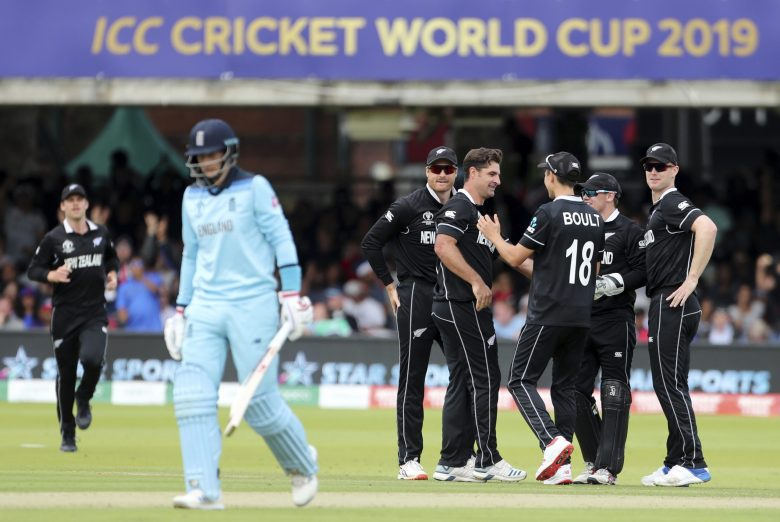 New Zealand's Colin de Grandhomme, center without cap, celebrates with teammates the dismissal of England's Joe Root, second left