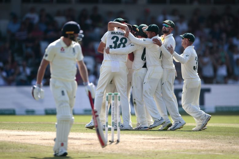 Australia's Josh Hazlewood, centre left, celebrates with teammates after taking the wicket of England's Chris Woakes, left, caught by Travis Headfor 1 on the fourth day of the 3rd Ashes Test cricket match