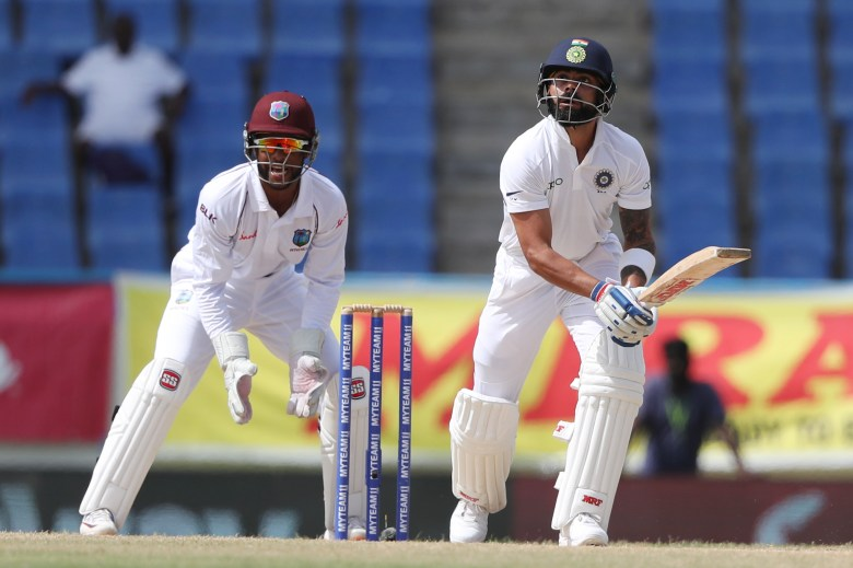 India's captain Virat Kohli eyes the ball after playing a shot to be caught by West Indies' John Campbell