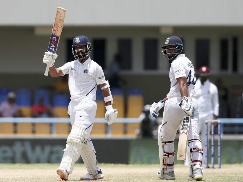 India's Ajinkya Rahane celebrates after he scored a century against West Indies