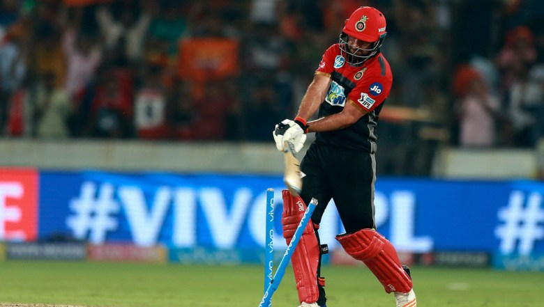 Royal Challengers Bangalore player Colin de Grandhomme reacts after bowled by Sunrisers Hyderabad's bowler Bhuvneshwar Kumar