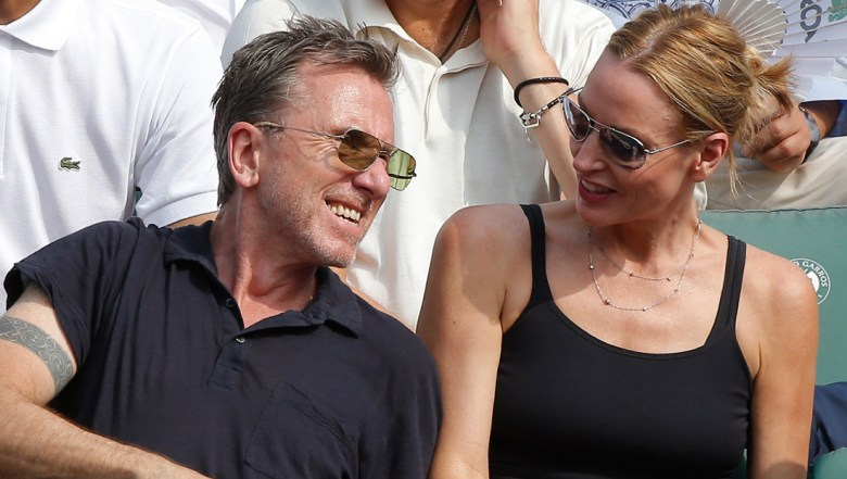 British actor and director Tim Roth and his wife Nikki Butler watch the men's final match of the French Open tennis tournament at the Roland Garros stadium in Paris