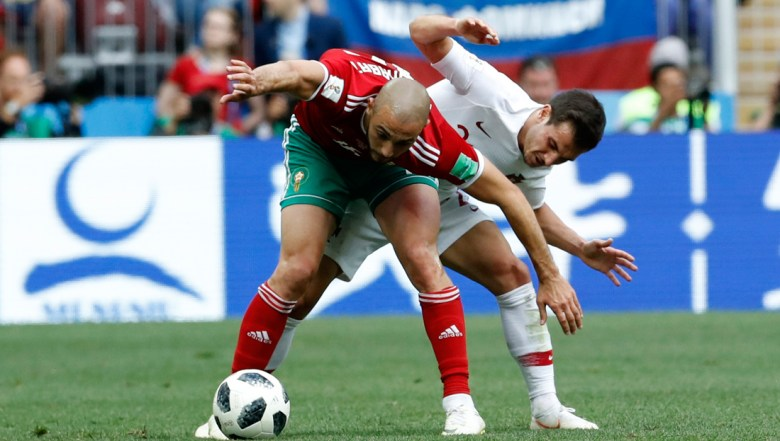 Morocco's Noureddine Amrabat, left, fights for the ball with Portugal's Bruno Alves during the group B match between Portugal and Morocco at the 2018 soccer World Cup at the Luzhniki Stadium in Moscow