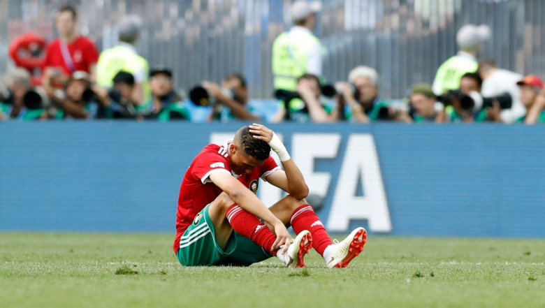 Morocco's Nabil Dirar sits on the ground at the end of the group B match between Portugal and Morocco at the 2018 soccer World Cup at the Luzhniki Stadium in Moscow