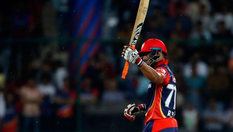 Delhi Daredevils' Rishabh Pant raises his bat scoring fifty runs