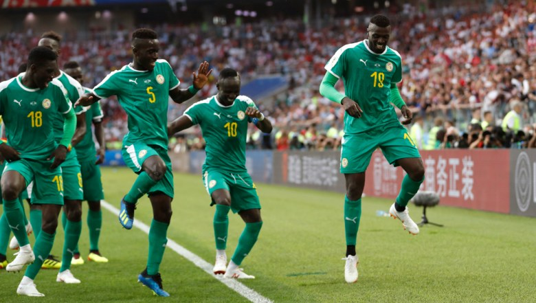 Senegal's Mbaye Niang, right, dances in celebration with his teammates scoring his side's second goalduring the group H match between Poland and Senegal at the 2018 soccer World Cup in the Spartak Stadium in Moscow