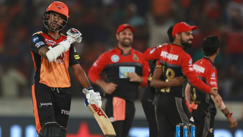 Sunrisers Hyderabad player Shikhar Dhawan backs to pavilion after dismissed by Royal Challenger's bowler Mohammed Siraj