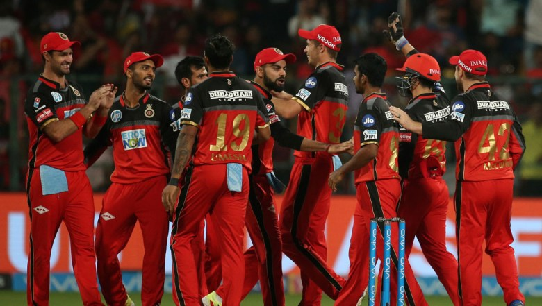 Players of Royal Challengers Bangalore celebrate the dismissal of Kolkata Knight Riders' Sunil Narine