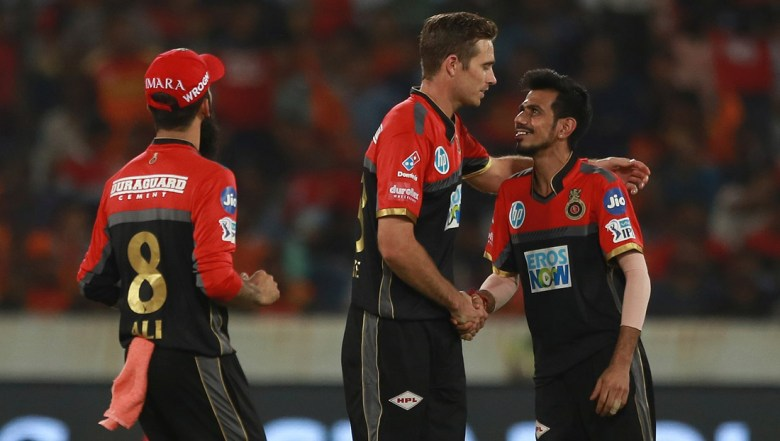 Royal Challengers Bangalore bowler Tim Southee, centre, celebrates the wicket of Shakib Al Hasan with Yuzvendra Chahal