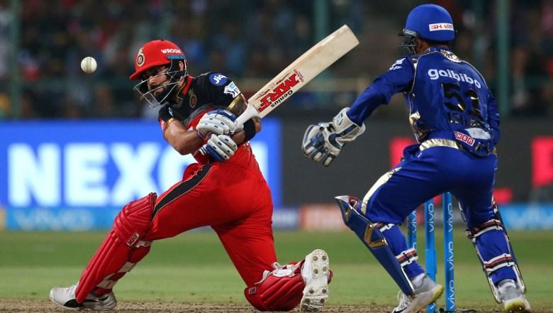 Royal Challengers Bangalore captain Virat Kohli, left, plays a shot during the VIVO IPL Twenty20 cricket match against Mumbai Indians
