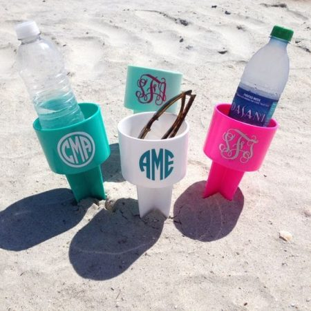 Personalized spikers for the beach to hold your beverages. Make the decals with your Cricut
