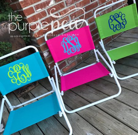 A set of monogrammed beach chairs