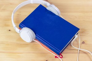 A book with headphones attached