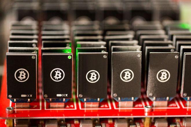 26082278 - bitcoin mining usb devices on a large usb hub.