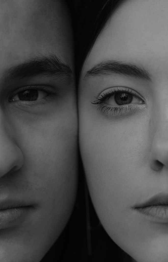 crop young calm couple faces together