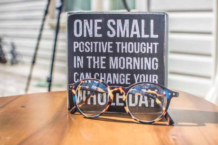 board that says to be positive