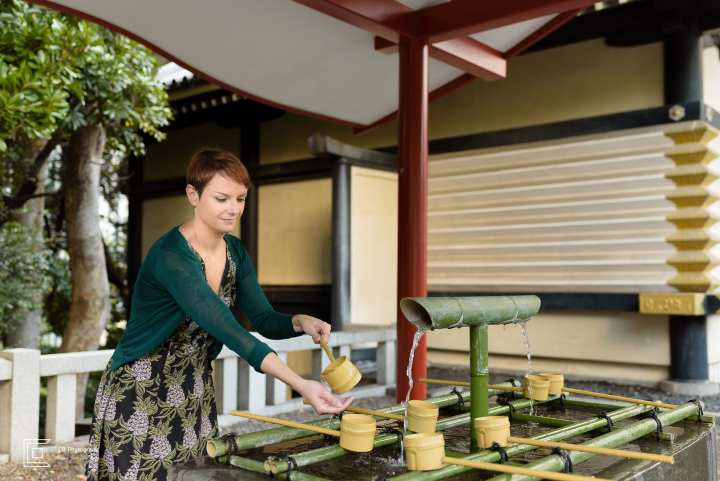 Travel Photograph showing how to wash the hands, a ritual before visiting a shrine in Japan by Cristian Bucur Photographer in Tokyo Metropolitan Area