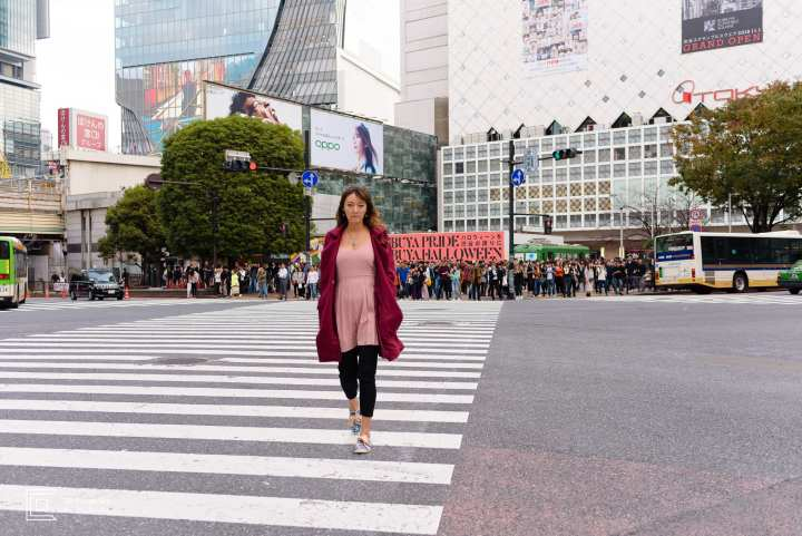 Portrait of a young woman crossing the Shibuya iconic scramble intersection by the Tokyo portrait photographer Cristian Bucur