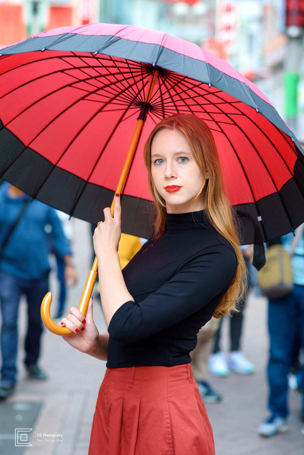 Portrait of a model with a Japanese umbrella from a portrait shoot in Shibuya by the Tokyo Photographer Cristian Bucur