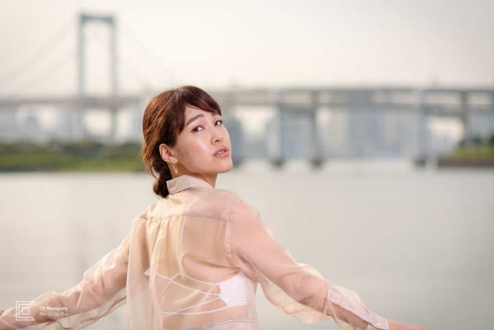 Portrait Photoshoot in Odaiba, Tokyo for personal branding of a model with Tokyo's skyline and Rainbow Bridge in the background.