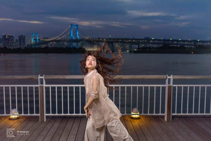 Personal branding night portrait shoot in Odaiba-Tokyo, with Rainbow Bridge lit in the background