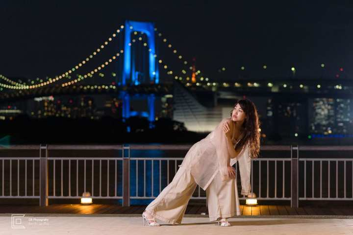 Portrait photoshoot session at night in Odaiba-Tokyo, with Rainbow Bridge lit in the background