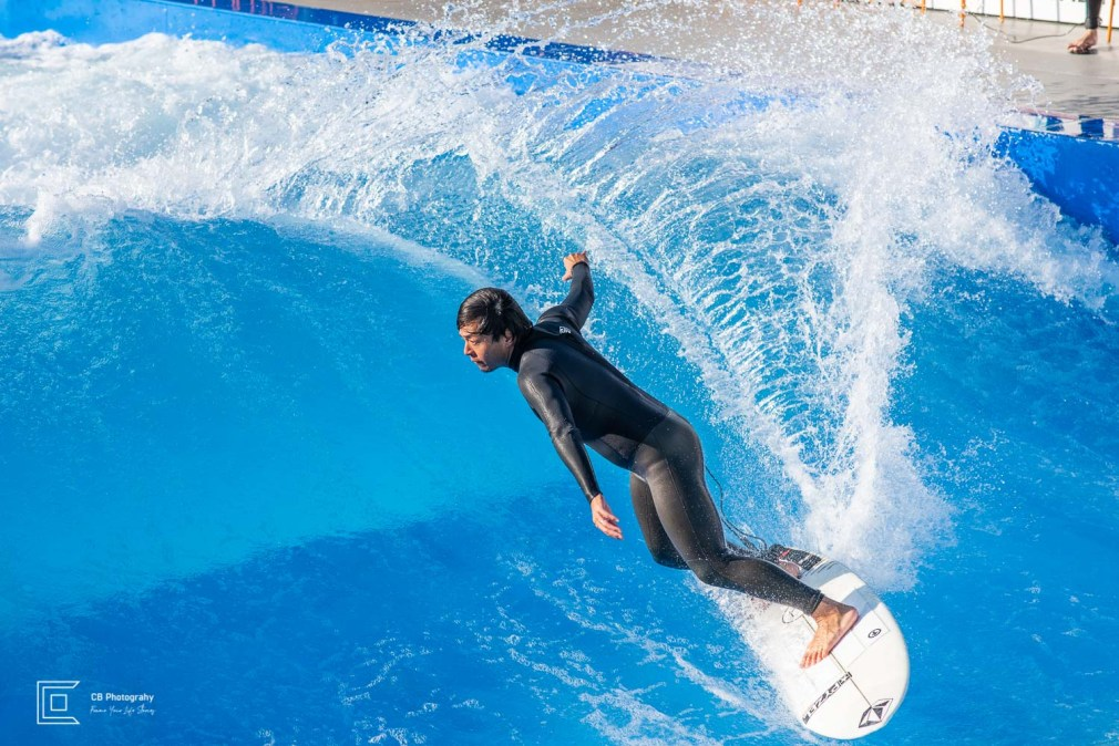 Surfer splashing waves trail at Citywave Tokyo