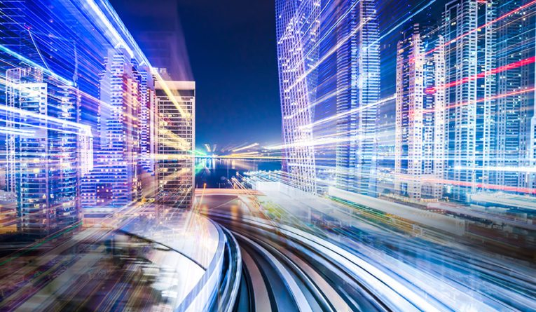 Digital composite of a train traveling through a futuristic city.
