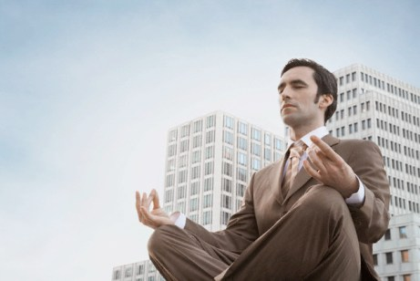Businessman in lotus position