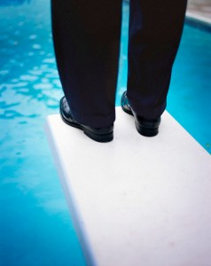 Businessman Standing on Diving Board