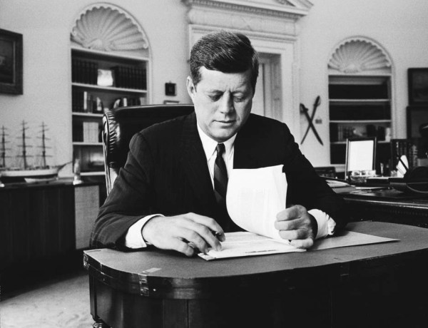 President John F Kennedy working at his desk in the Oval Of