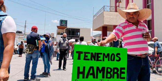 Comerciantes de Tlahuelilpan se manifiestan en demanda de instalación