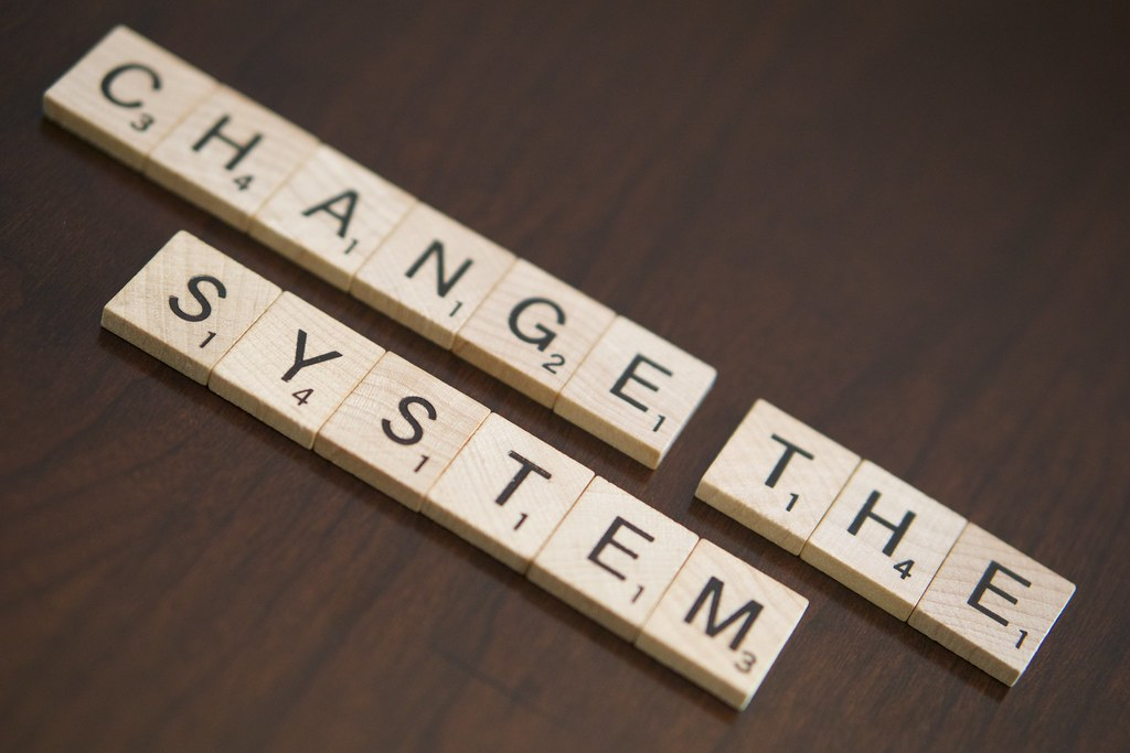 """Change the System"" by burrows.nichole28 is licensed under CC BY 2.0"