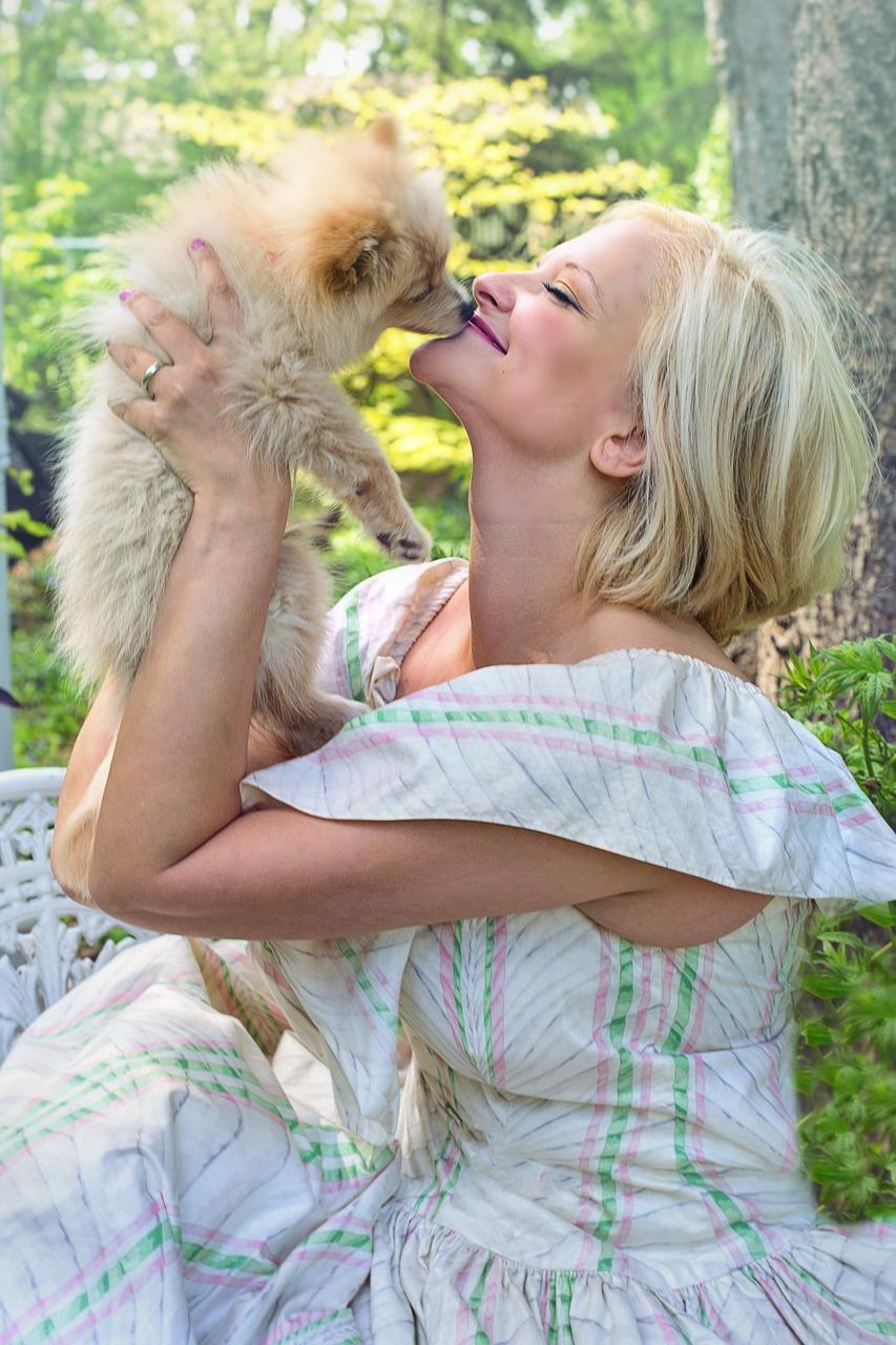 woman happy pet sitting dog