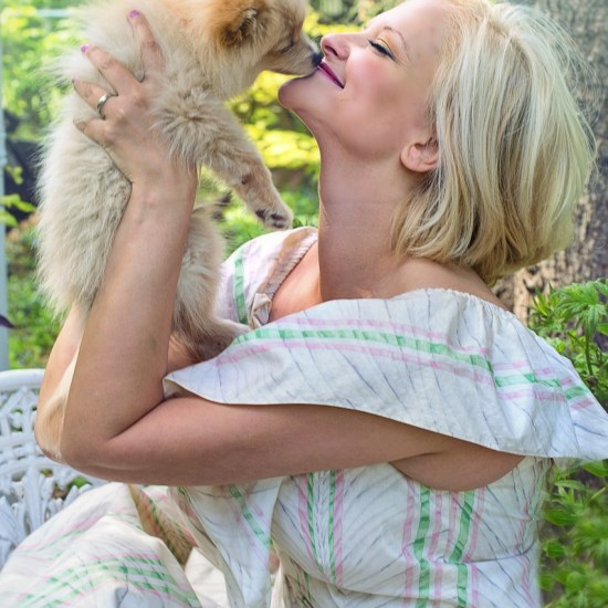 woman happy pet sitting dog
