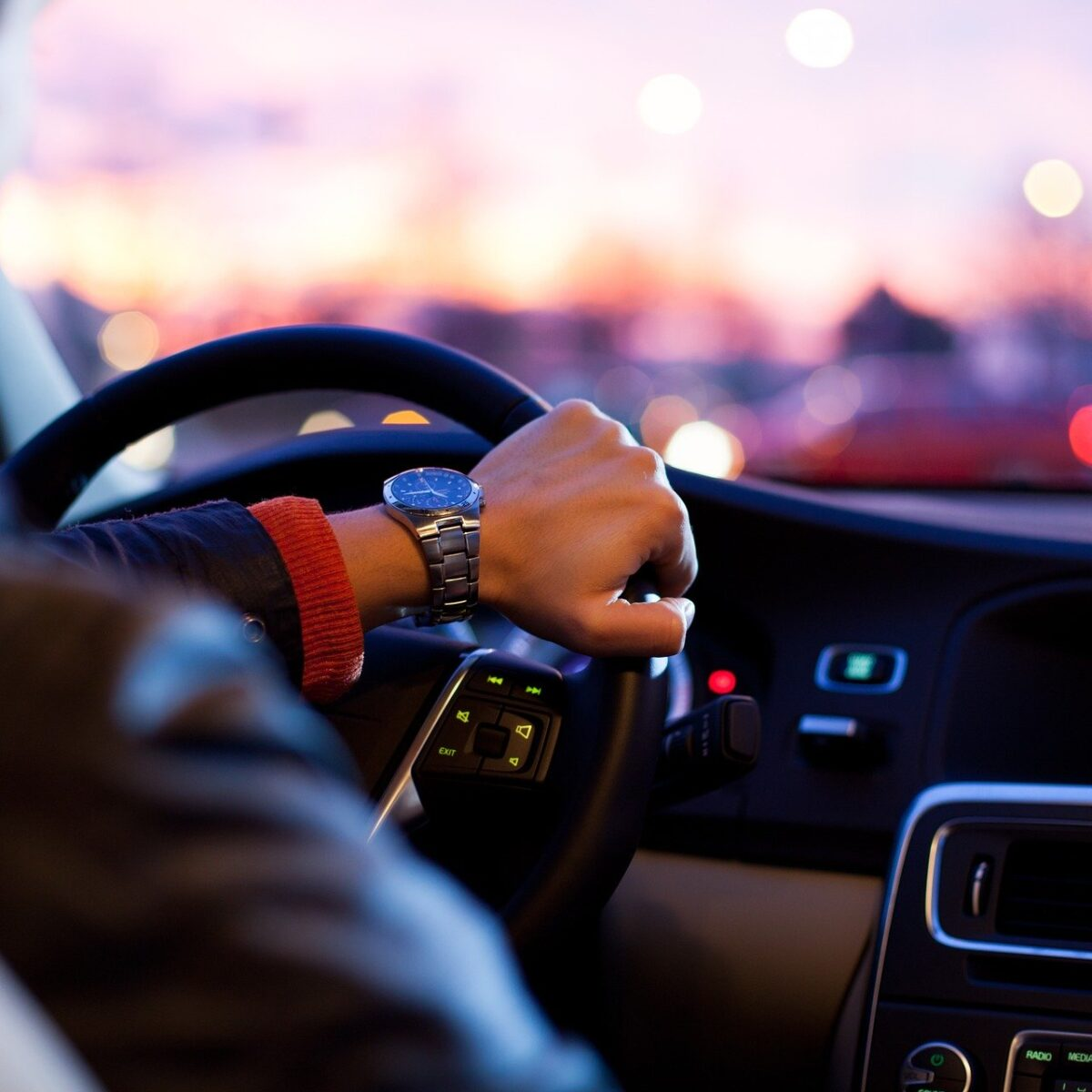 man driving car insurance