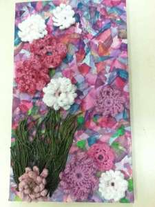 crochet flowers and mixed media wallhanging