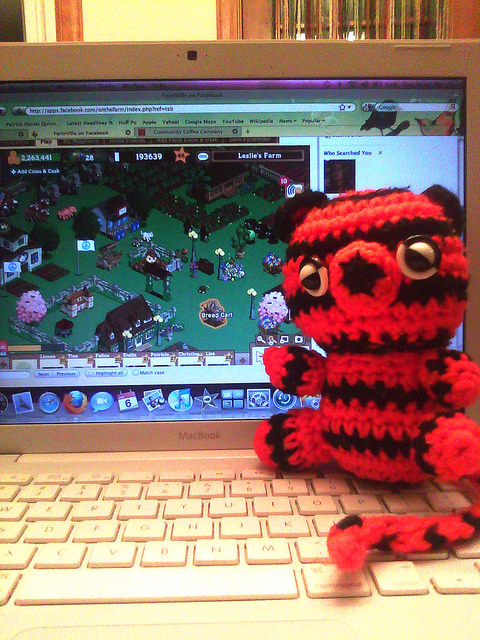 Boo-Boo the crochet tiger returns home happy to be play  Farmville