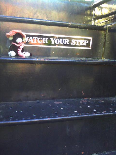 crochet monkey on a train step