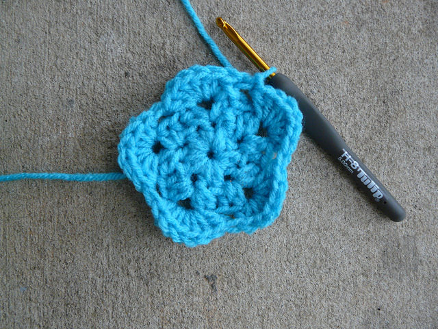 Round three of a crochet pentagon