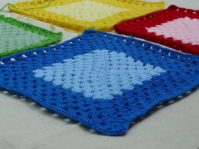 View from the perspective of the blue crochet square of the pattern I am road testing