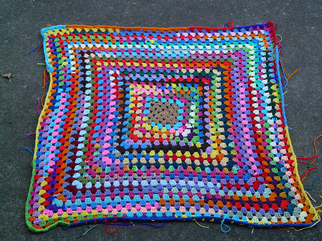 large granny square crocheted from yarn scraps