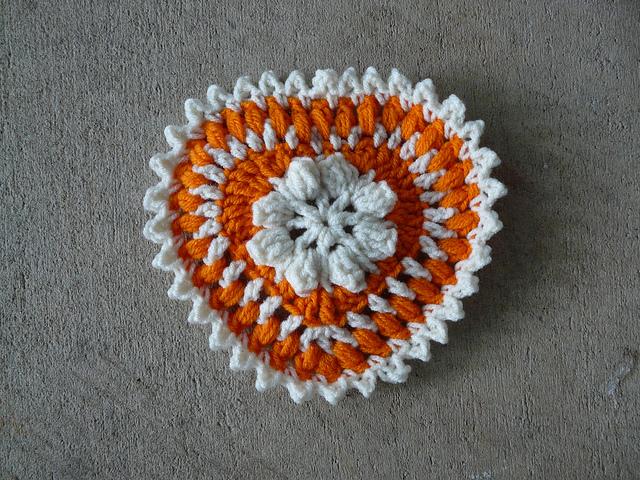 Orange and white textured crochet heart