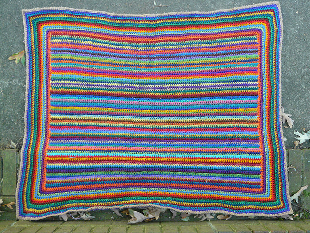 An overview of the striped scrap crochet afghan that is part of my one day hiatus