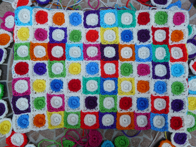 A detail of the Hilbert curve made into a crochet afghan with crochet squares as the foundation motif