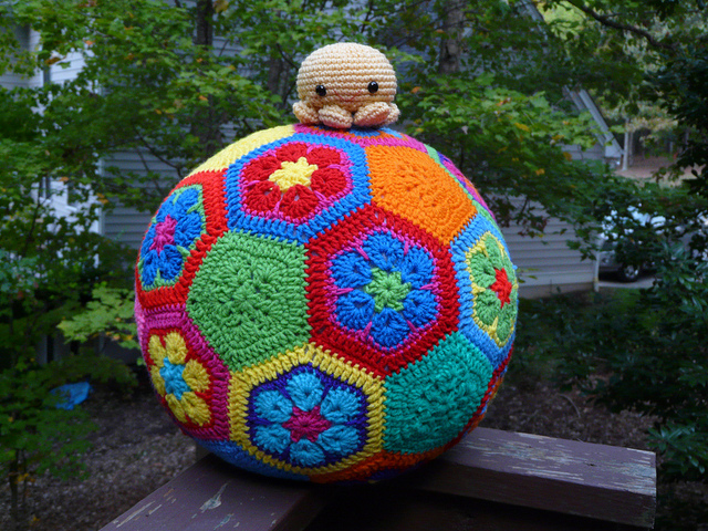 crochet octopus amigurumi on top of a crochet soccer ball